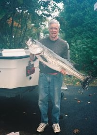 Mike_Bothner_PhD_with_striped_bass